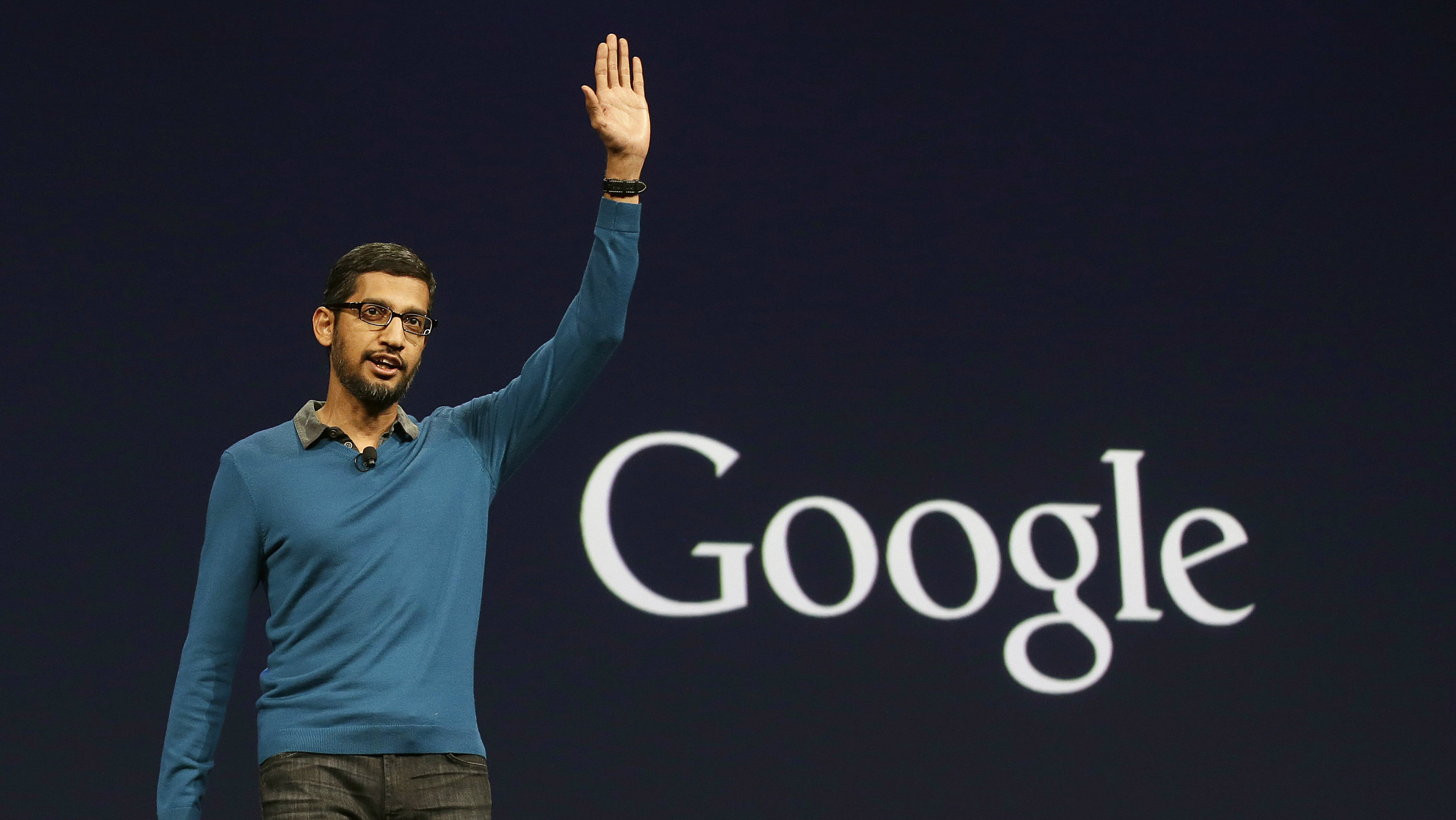 File - In this Thursday, May 28, 2015 file photo, Sundar Pichai, senior vice president of Android, Chrome and Apps, waves after speaking during the Google I/O 2015 keynote presentation in San Francisco. Google is creating a new company, called Alphabet, to oversee its highly lucrative Internet business and a growing flock of other ventures, including some — like building self-driving cars and researching ways to prolong human life — that are known more for their ambition than for turning an immediate profit. Pichai will become CEO of Google's core business, including its search engine, online advertising operation and YouTube video service. (AP Photo/Jeff Chiu, File)