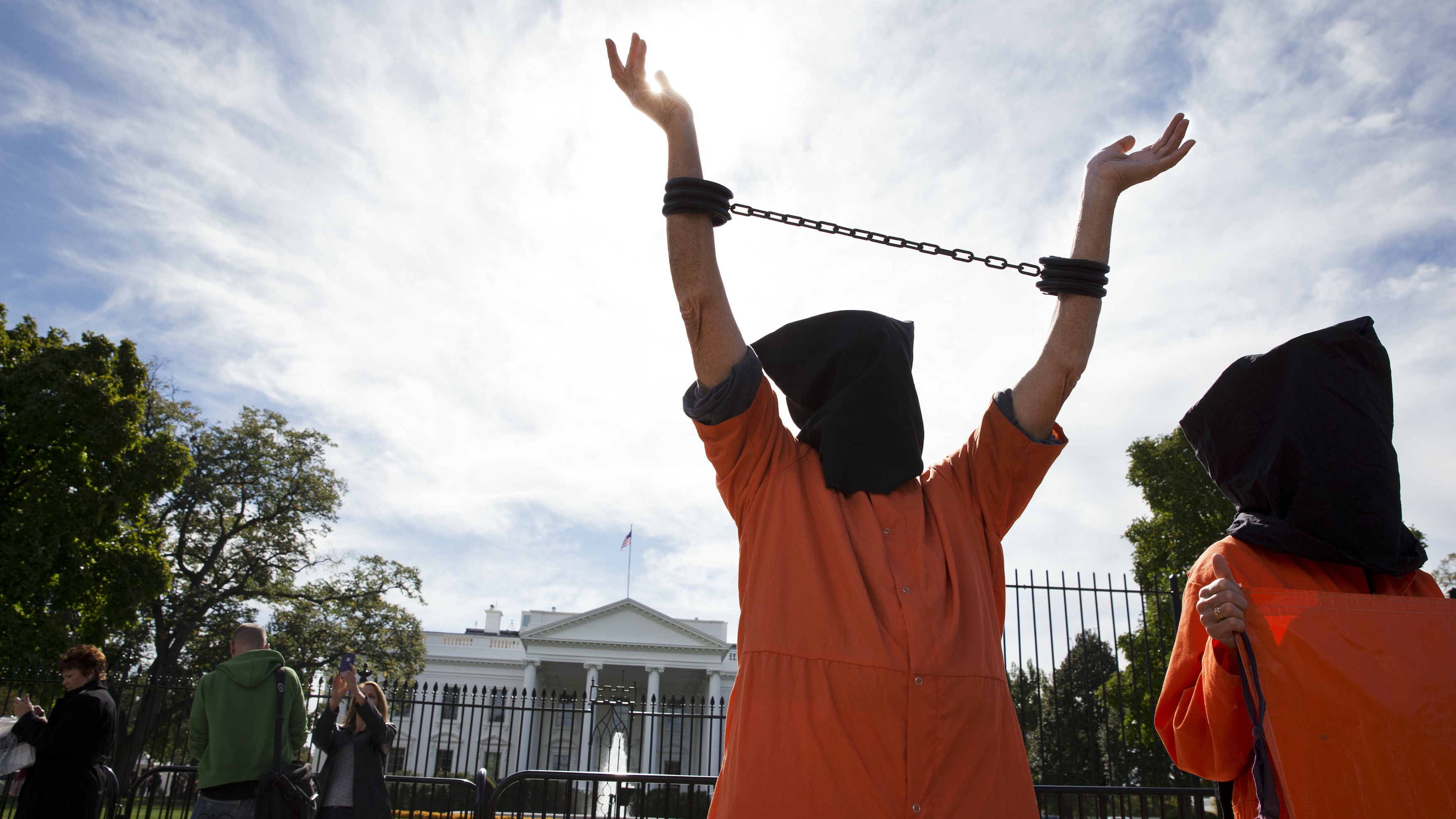 "People protest against ""indefinite detentions"" at Guantanamo Bay detention center outside of the White House in Washington, DC, in Oct. 2014."