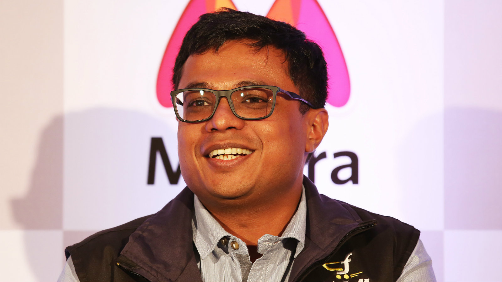 Flipkart CEO Sachin Bansal addresses a news conference in Bangalore, India, 12 May 2015. India's e-commerce giants Flipkart and largest online fashion retailer Myntra will become a mobile app-only shopping platform starting 15 May, which intended to accelerate a consumer shift towards using smartphones to shop online, save cost and reduce dependence. The number of mobile Internet users in India is expected to reach 213 million by June, according to a 2014 report and it will be approximately 480 million mobile Internet users by end of 2017.