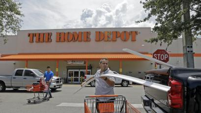 A man loads garage door trims into his pickup truck outside a Home Depot in Hialeah, Florida.
