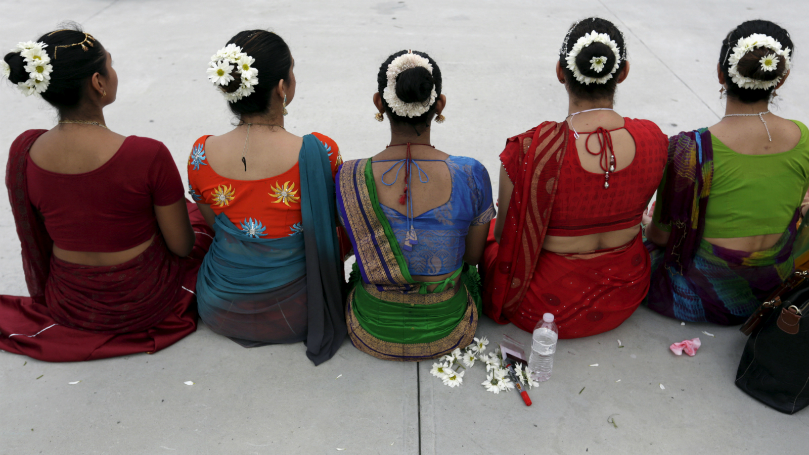 Women from the Hindu community rest during the annual Ratha Yatra celebration in Panama City June 6, 2015.