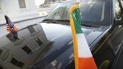A vehicle from the Irish delegation, flying Ireland and U.S. flags, sits in the driveway during a 2013 St. Patrick's Day reception at the White House in Washington, DC.