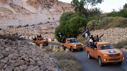 An armed motorcade belonging to members of Derna's Islamic Youth Council, consisting of former members of militias from the town of Derna, drive along a road in Derna, eastern Libya October 3, 2014. The group pledged allegiance to the Islamic State on October 3, 2014 local media reported. Picture taken October 3, 2014.