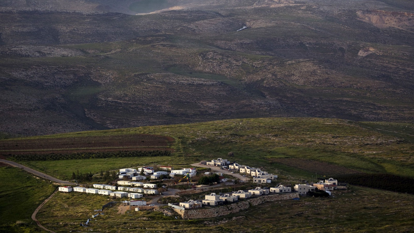 The Jewish settlement of Mitzpe Kramim east of the West Bank city of Ramallah is seen March 25, 2015. Israeli Prime Minister Benjamin Netanyahu walks the tightrope between his political allegiances and the international community, whose faith in his commitment to a two-state solution with the Palestinians - including a halt to settlement-building - is wearing thin. About to begin his fourth term, likely this time at the head of a heavily right-leaning coalition, Netanyahu will be watched closely, at home and abroad, for any moves on settlements, after he ruled out any future Palestinian state before the poll. Picture taken March 25, 2015. To match Insight ISRAEL-PALESTINIANS/SETTLEMENTS  REUTERS/Ronen Zvulun  - RTR4W920