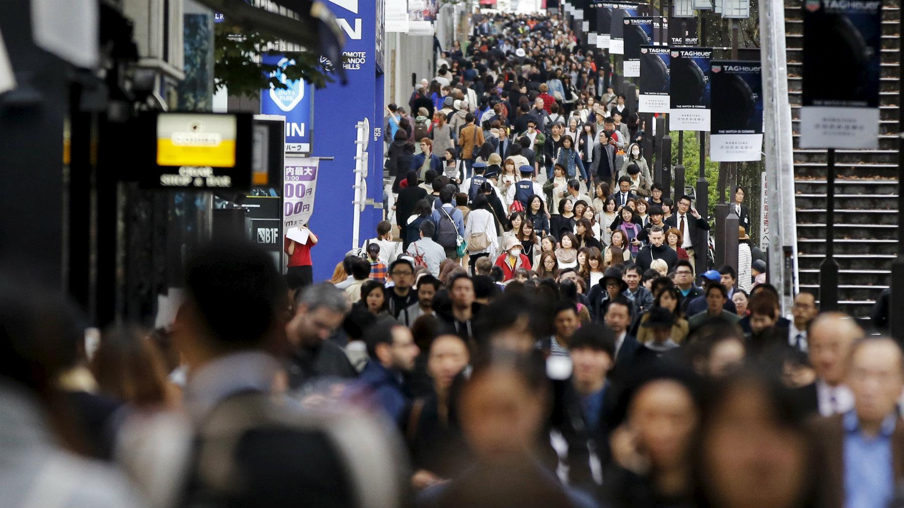 People walk in Tokyo's Omotesando shopping district.