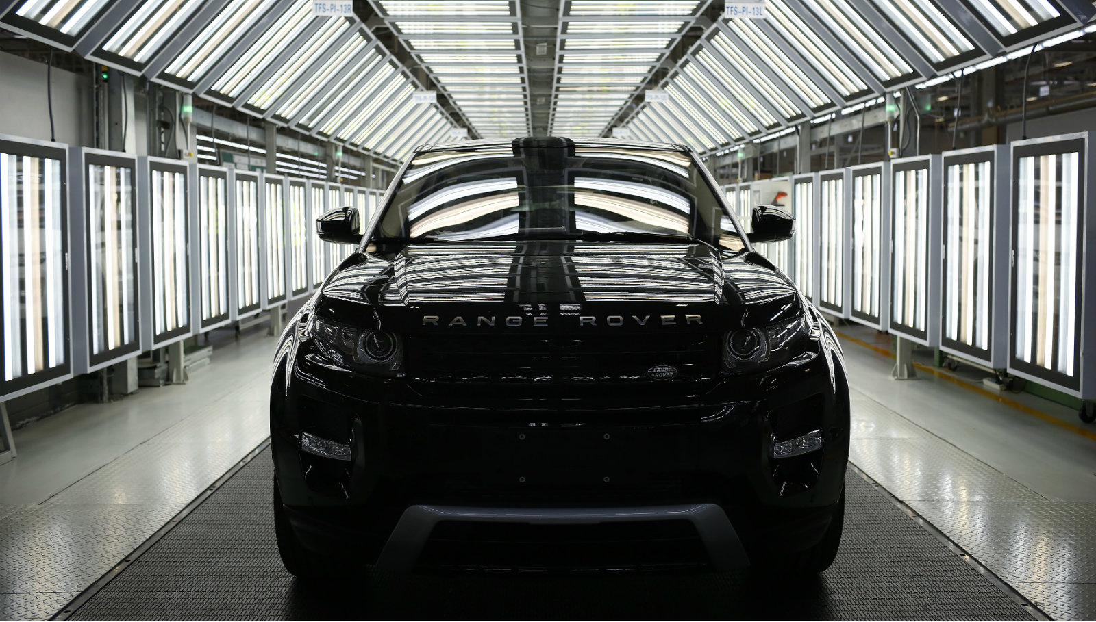 A Land Rover Evoque car is seen on the production line inside the Chery Jaguar Land Rover plant before the plant opening ceremony in Changshu, Jiangsu province, October 21, 2014. British luxury carmaker Jaguar Land Rover Ltd, owned by Indian conglomerate Tata group, expects its China sales to grow 20 percent this year, Greater China head Bob Grace said on Tuesday.