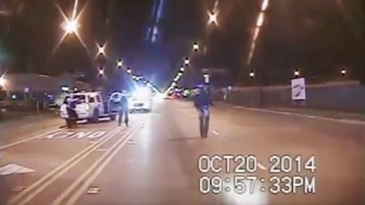 In this Oct. 20, 2014 frame from dash-cam video provided by the Chicago Police Department, Laquan McDonald, right, walks down the street moments before being shot by officer Jason Van Dyke in Chicago. Van Dyke, who shot McDonald 16 times, was charged with first-degree murder Tuesday, Nov. 24, 2015. (Chicago Police Department via AP)