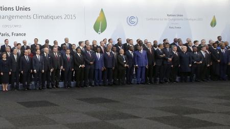 Heads of states and governments pose for a family photo during the opening day of the World Climate Change Conference 2015