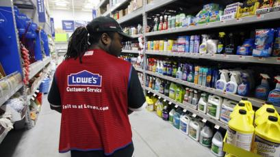 A Lowe's employee walks down an aisle in the store in Saugus, Massachusetts.