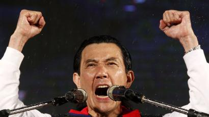 Taiwan President and Nationalist Party (KMT) presidential candidate Ma Ying-jeou celebrates after provisional election results of the Taiwan's 2012 presidential election are announced in Taipei January 14, 2012.