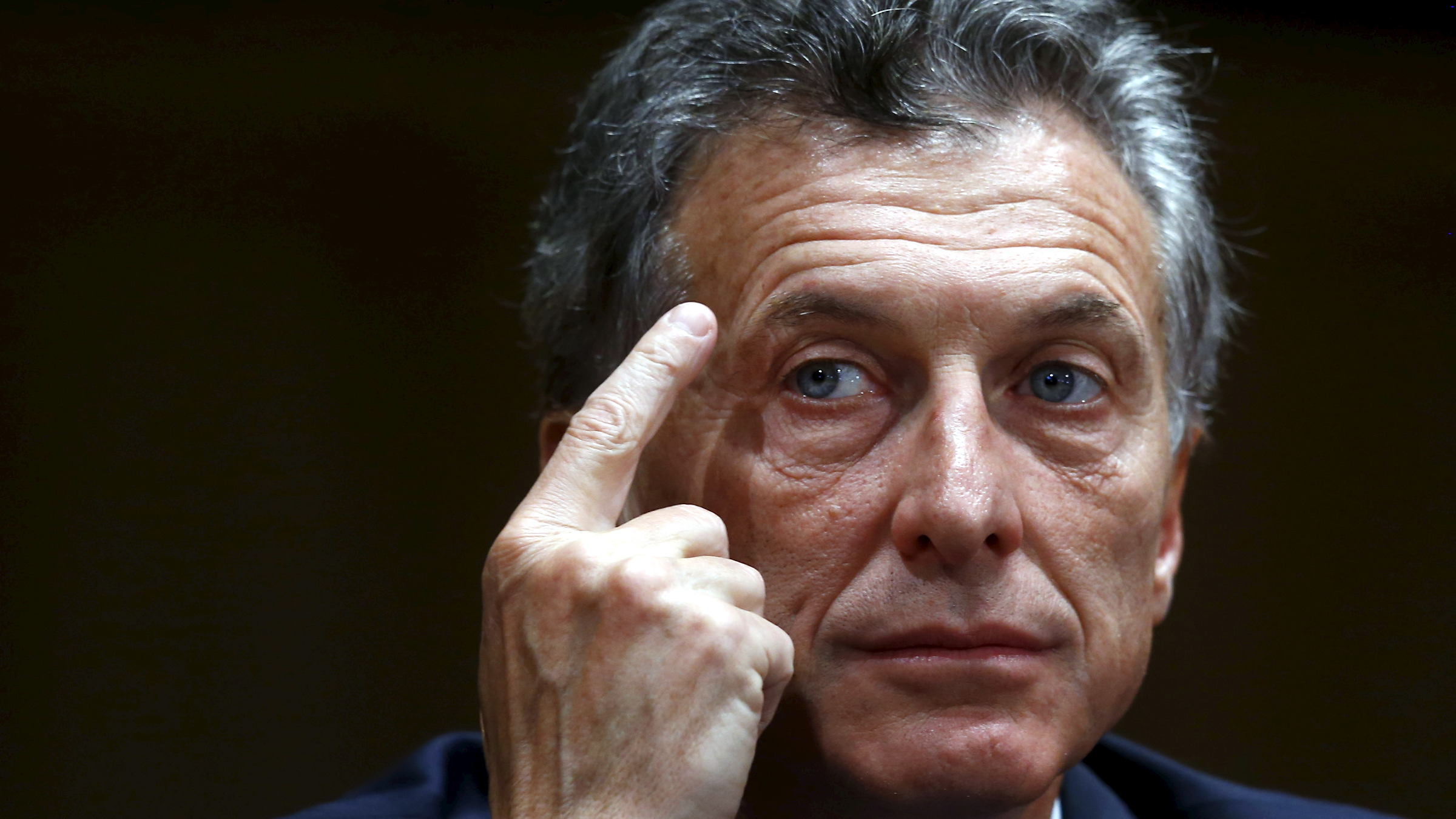 Argentina's president-elect Mauricio Macri smiles during a news conference in Buenos Aires, Argentina, November 23, 2015. Argentines assets rose broadly on Monday after conservative opposition challenger Macri scraped to victory in the presidential election, ending more than a decade of rule under the Peronist movement