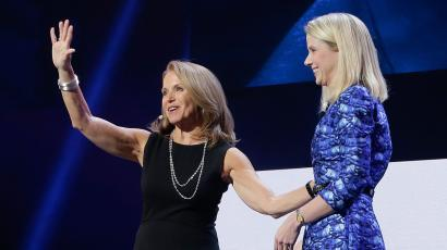 Former CBS News anchor Katie Couric waves to the audience next to Yahoo Yahoo president and CEO Marissa Mayer after speaking during a Yahoo presentation at the International Consumer Electronics Show, Tuesday, Jan. 7, 2014, in Las Vegas. (AP Photo/Julie Jacobson)