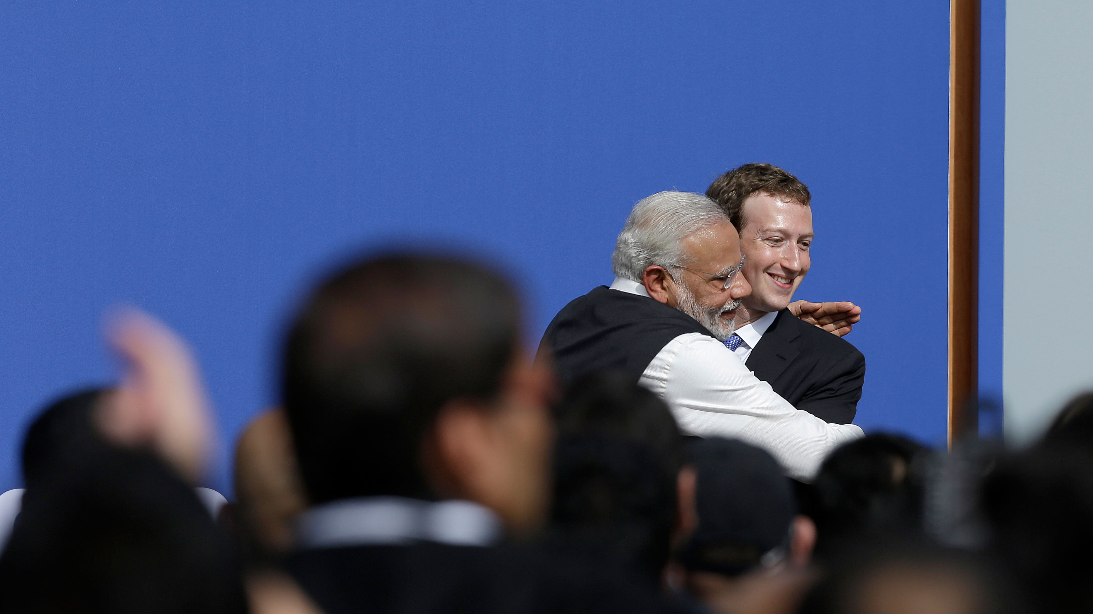 Facebook CEO Mark Zuckerberg, right, hugs Prime Minister of India Narendra Modi at Facebook in Menlo Park, Calif., Sunday, Sept. 27, 2015. A rare visit by Indian Prime Minister Narendra Modi this weekend has captivated his extensive fan club in the area and commanded the attention of major U.S. technology companies eager to extend their reach into a promising overseas market. (AP Photo/Jeff Chiu)