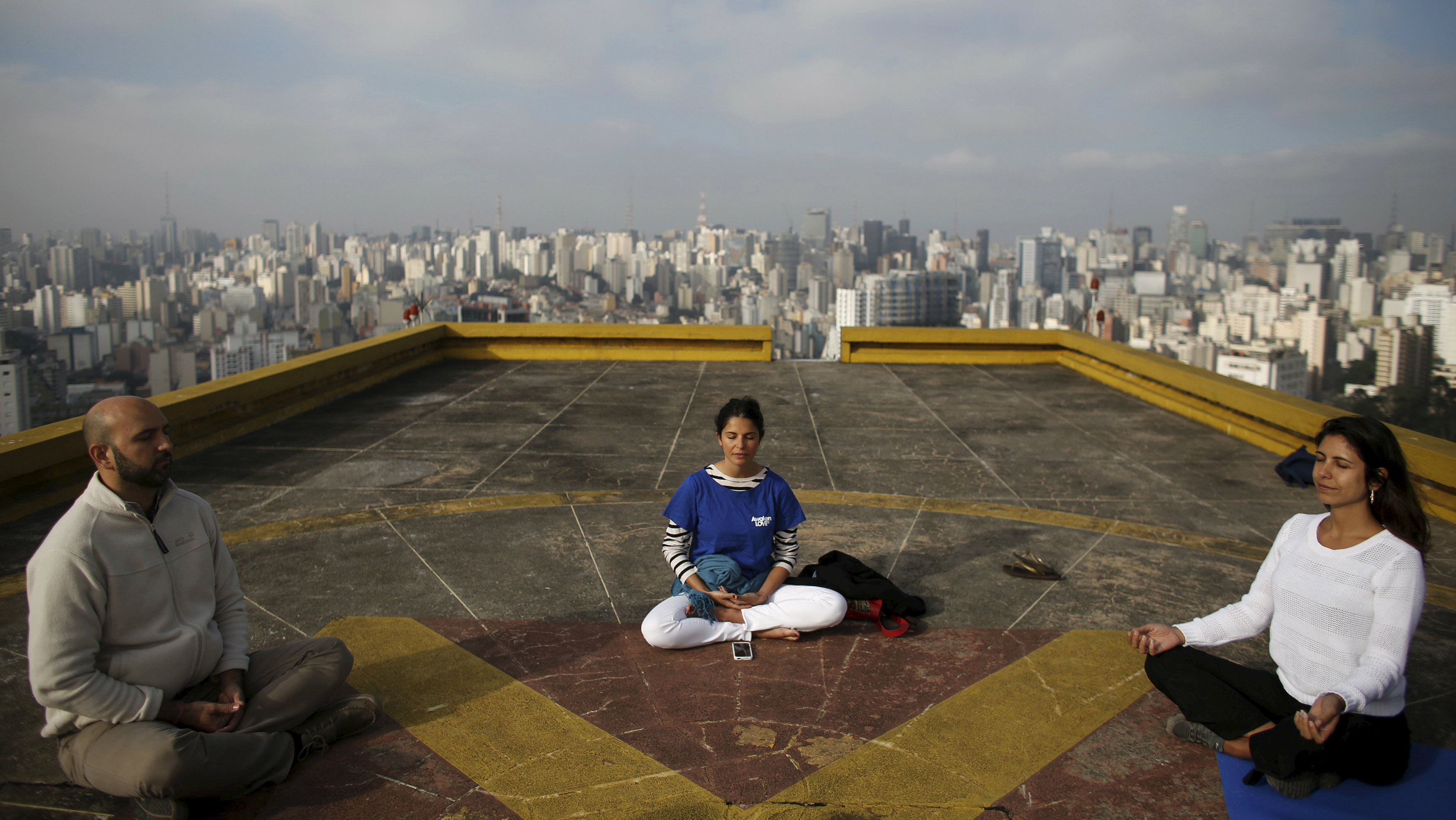 People meditate on the helipad of Copan building to celebrate World Health Day, which was observed on April 7, in downtown Sao Paulo April 9, 2015.
