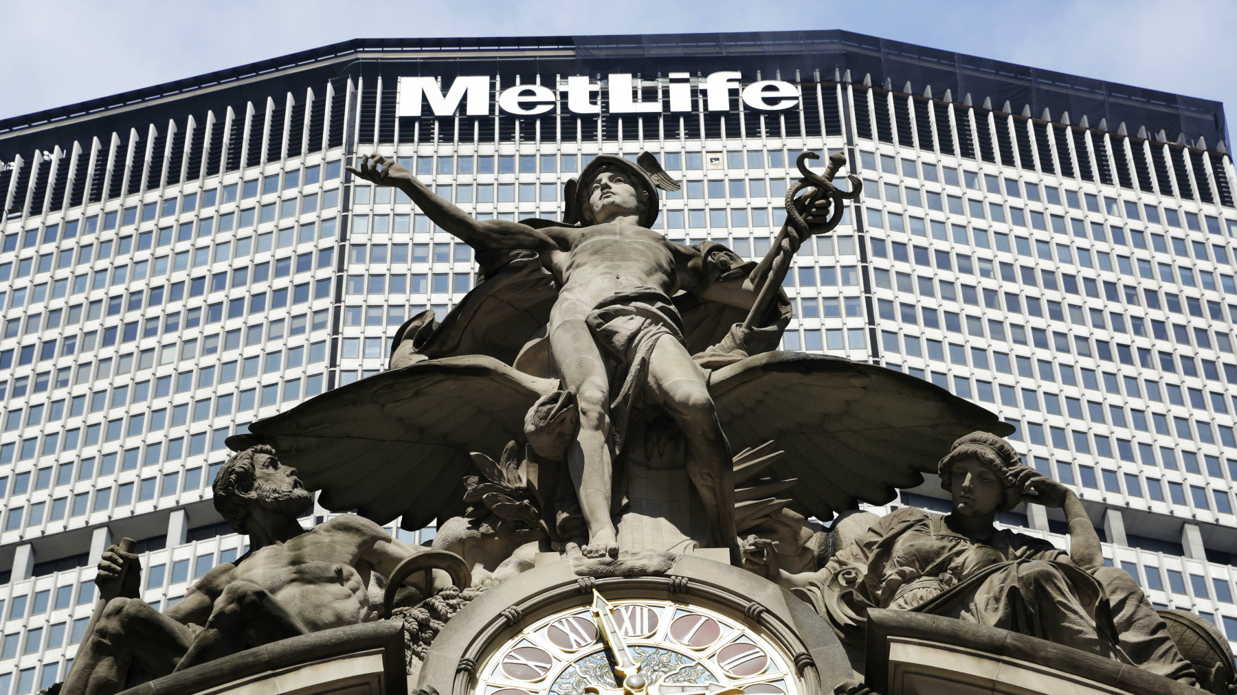 The MetLife building towers above Jules-Alexis Coutane's statue of Mercury on Grand Central Terminal in New York.
