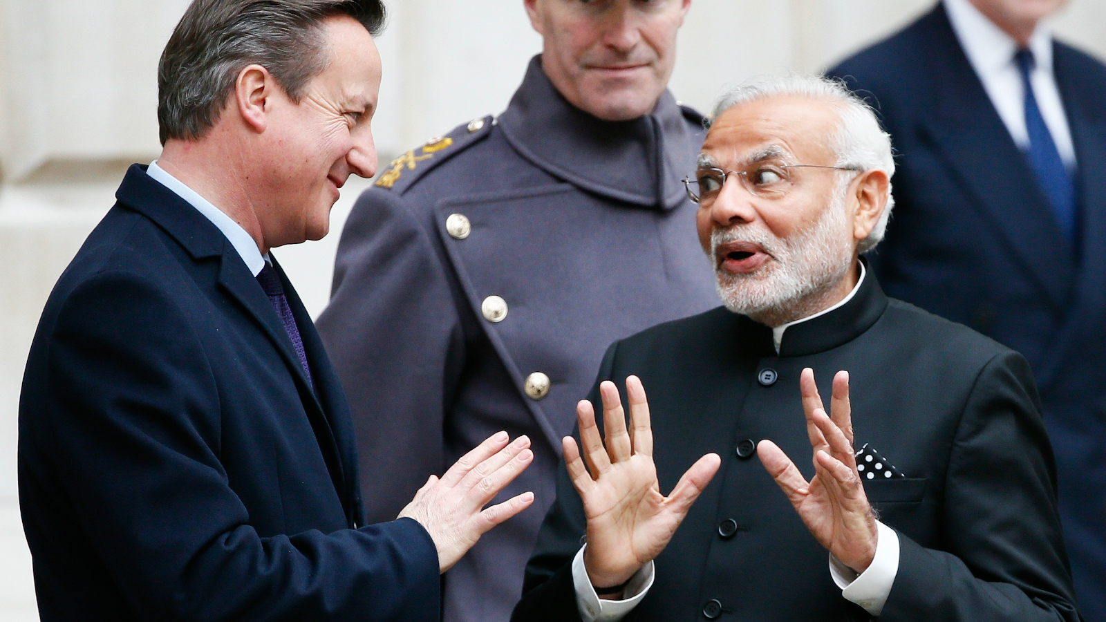 India's prime minister Narendra Modi's chats with Britain's prime minister David Cameron after the ceremonial welcome during his official visit, in London, November 12, 2015.