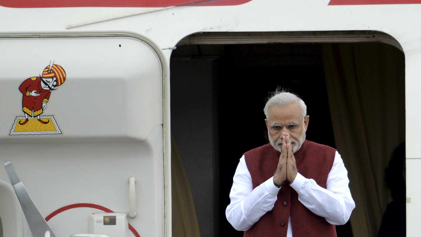 Indian Prime Minister Narendra Modi greets welcomers upon his arrival before attending the BRICS and the Shanghai Cooperation Organization (SCO) summits in Ufa, Russia, July 8, 2015. REUTERS/BRICS/SCO Photohost/RIA Novosti ATTENTION EDITORS - THIS IMAGE HAS BEEN SUPPLIED BY A THIRD PARTY. IT IS DISTRIBUTED, EXACTLY AS RECEIVED BY REUTERS, AS A SERVICE TO CLIENTS.