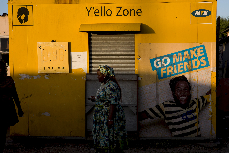 A resident walks past an MTN telecom shop in Gugulethu, Cape Town, November 7, 2015.