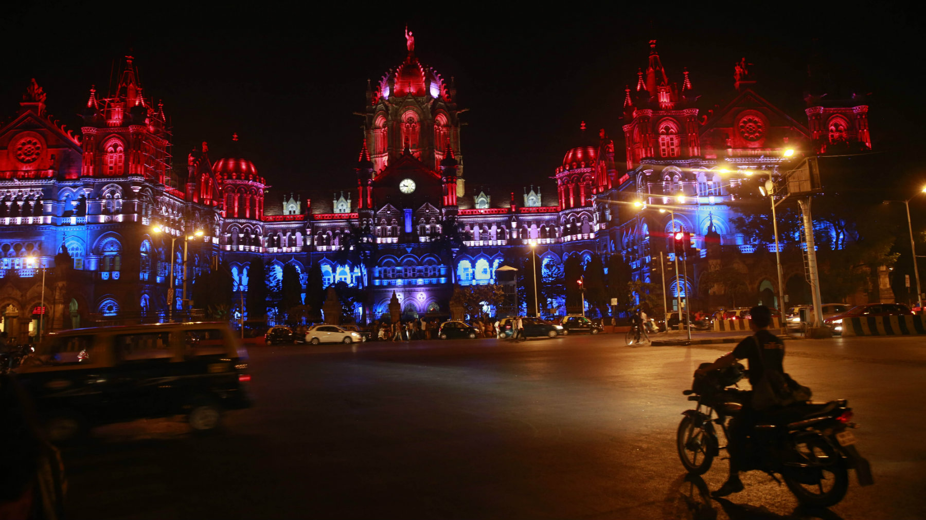Mumbai's Chhatrapati Shivaji train station building is illuminated by the colors of the French national flag in solidarity with France following the Nov. 13 Paris terror attacks.