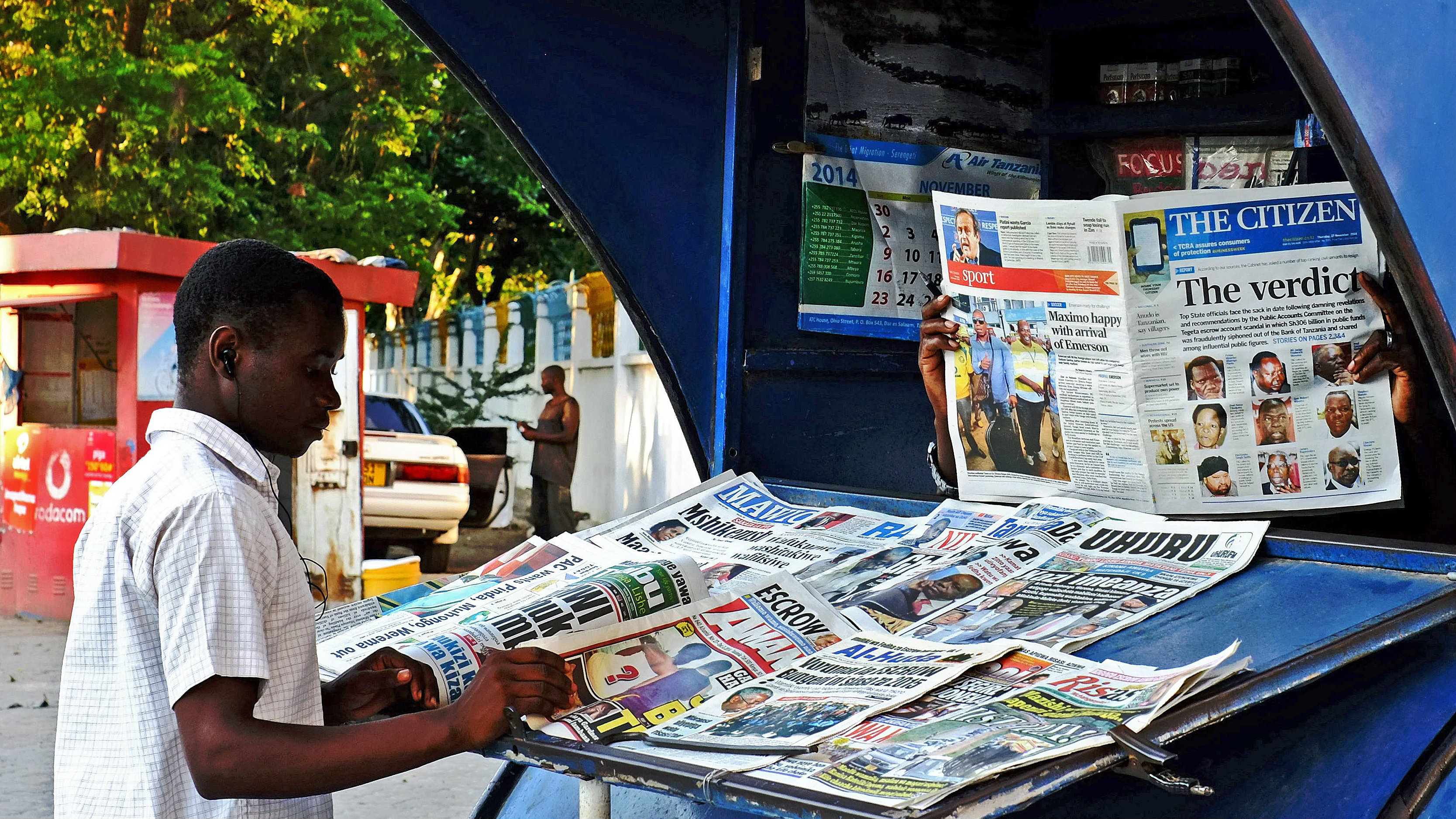 Tanzanian newspapers carry headlines on alleged corruption in Dar es Salaam, Tanzania on November 27, 2014