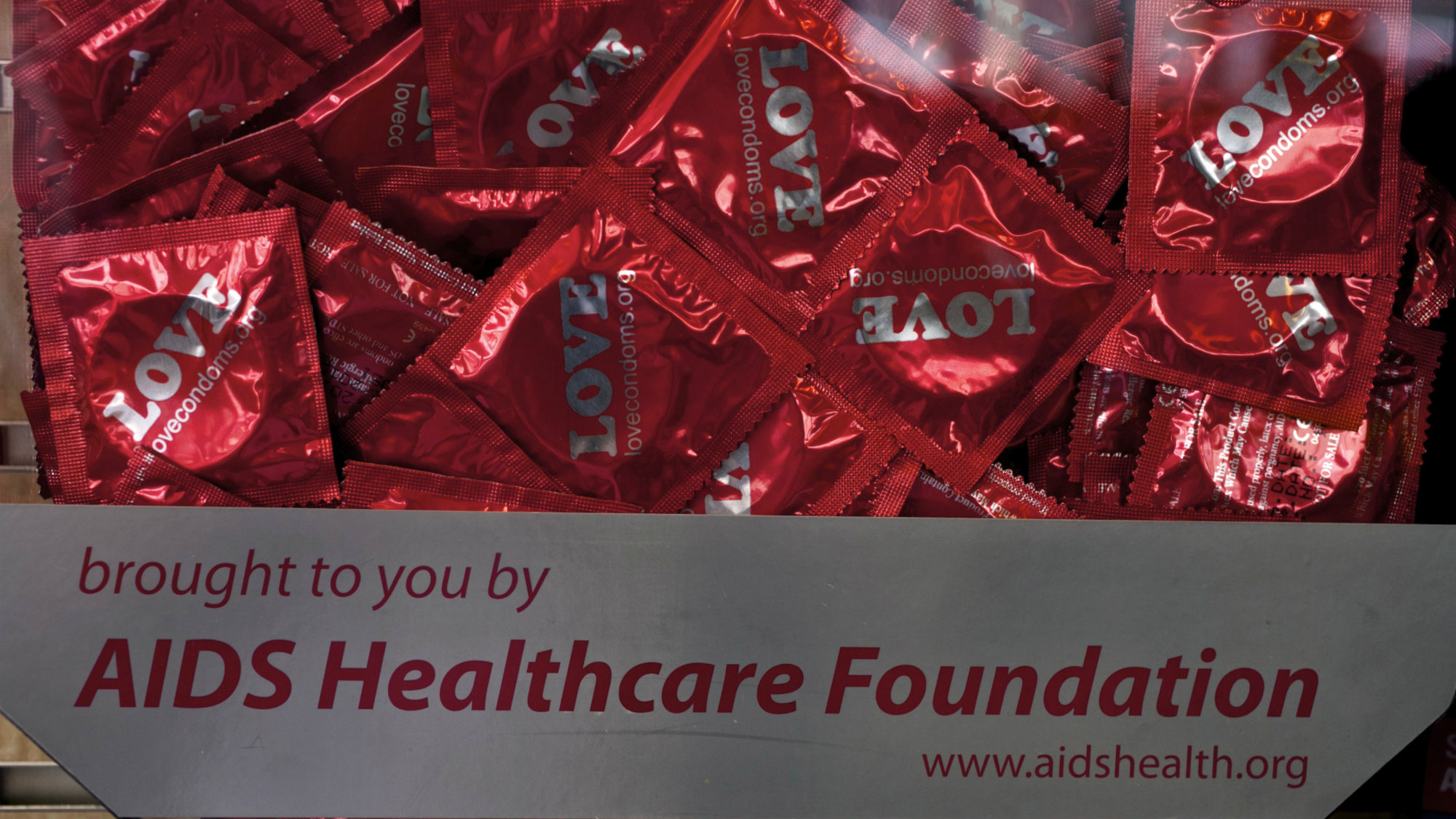 Condoms are offered at the AIDS Healthcare Foundation AHF Pharmacy in the Hollywood section of Los Angeles on Monday, Mar. 5, 2012.