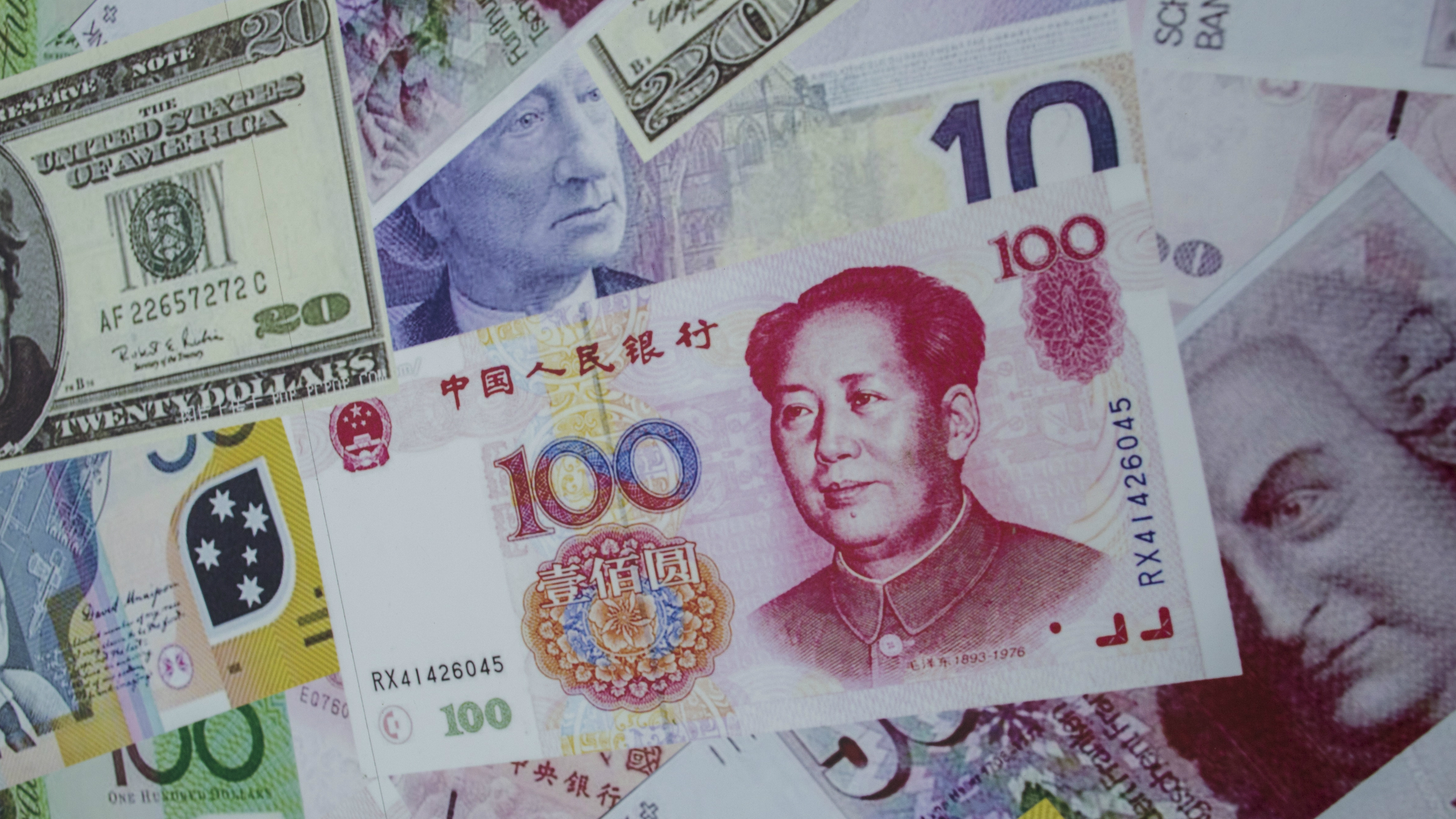 MARKETS-BONDS/EUROSYSTEM IDENTIFIER:RTR4YZ6MCODE:GF10000172717MEDIA DATE13 Aug. 2015PHOTOGRAPHER:Tyrone SiuHEADLINE:An advertisement promoting China's renminbi (RMB) or yuan, U.S. dollar and Euro exchange services is...