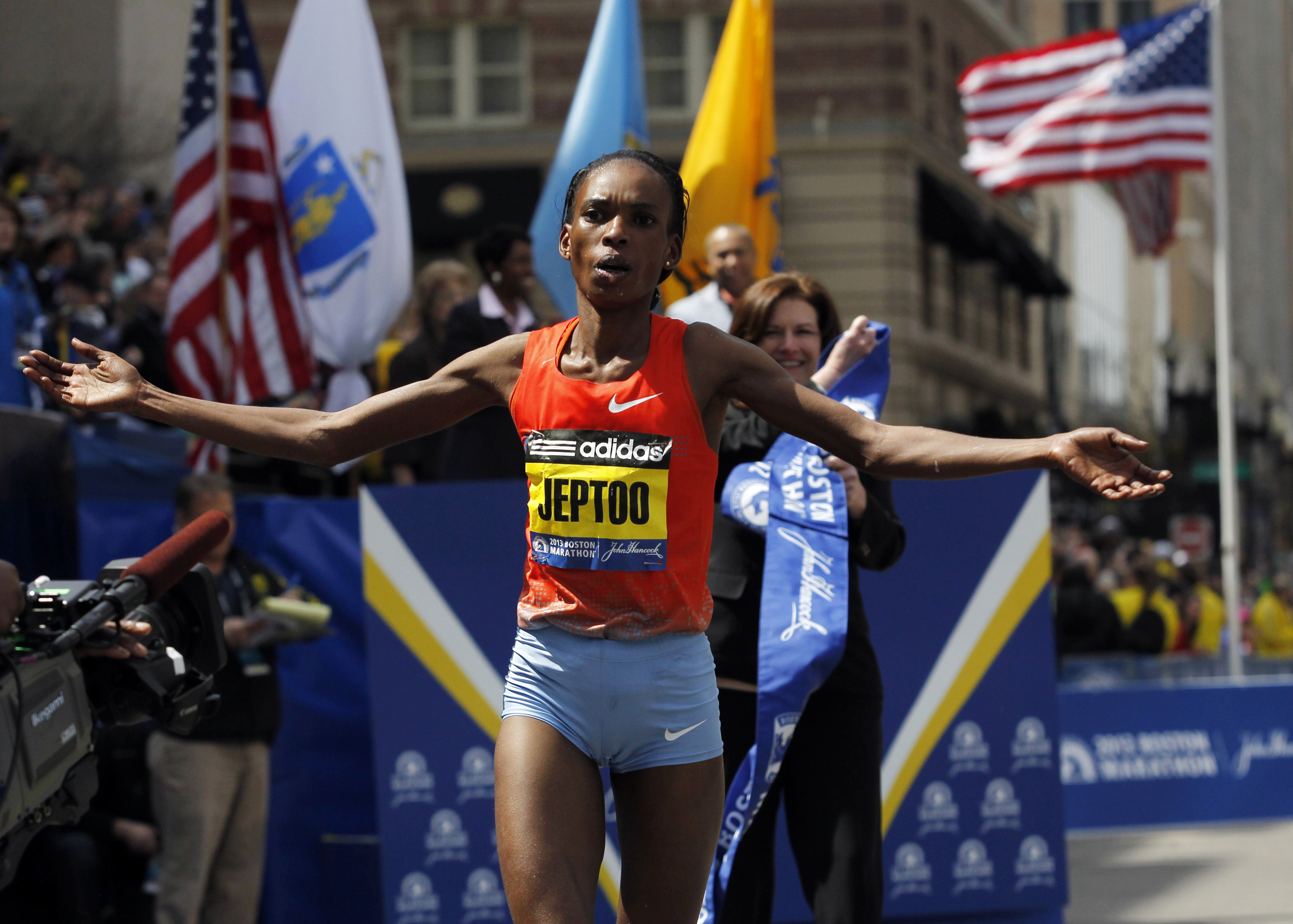 Rita Jeptoo of Kenya reacts after crossing the finish line to win the women's division of the 117th Boston Marathon in Boston, Massachusetts April 15, 2013.