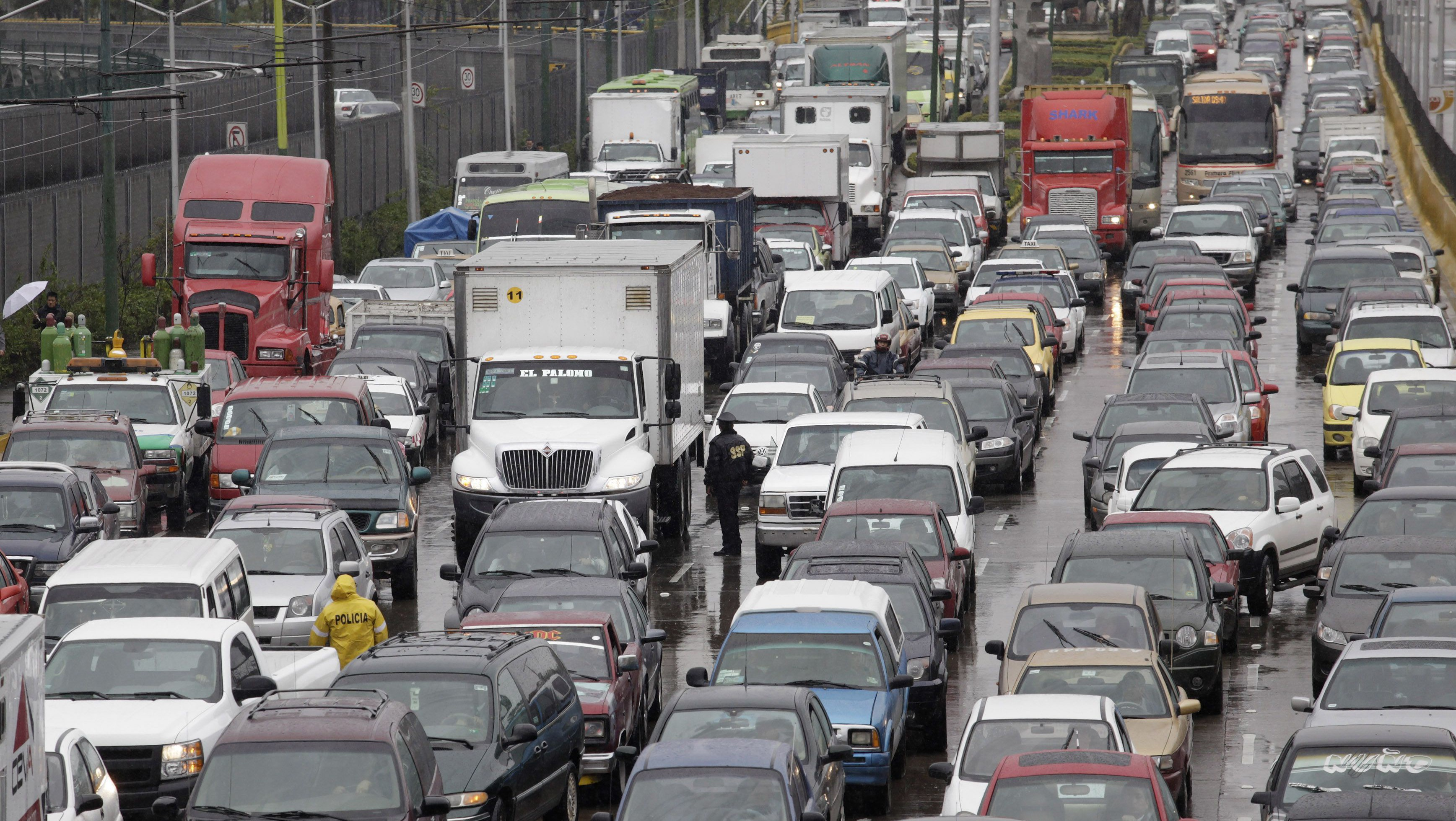 Traffic moves during rains in Mexico City