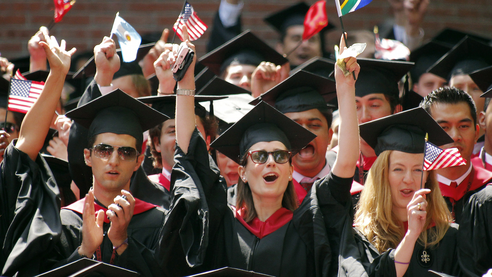 Graduates from the business school celebrate during Harvard University's 359th Commencement Exercises Harvard University in Cambridge, Massachusetts May 27, 2010.     REUTERS/Adam Hunger (UNITED STATES - Tags: EDUCATION SOCIETY) - RTR2EFYR