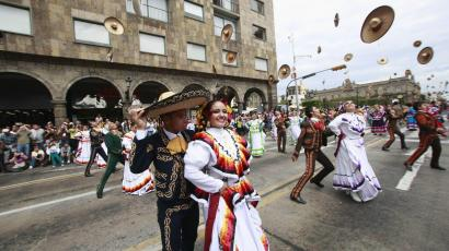 """Dancers in traditional outfits throw their hats during a performance as part of the fourth """"Jalisco is Culture"""" festival at Liberacion Square in Guadalajara"""