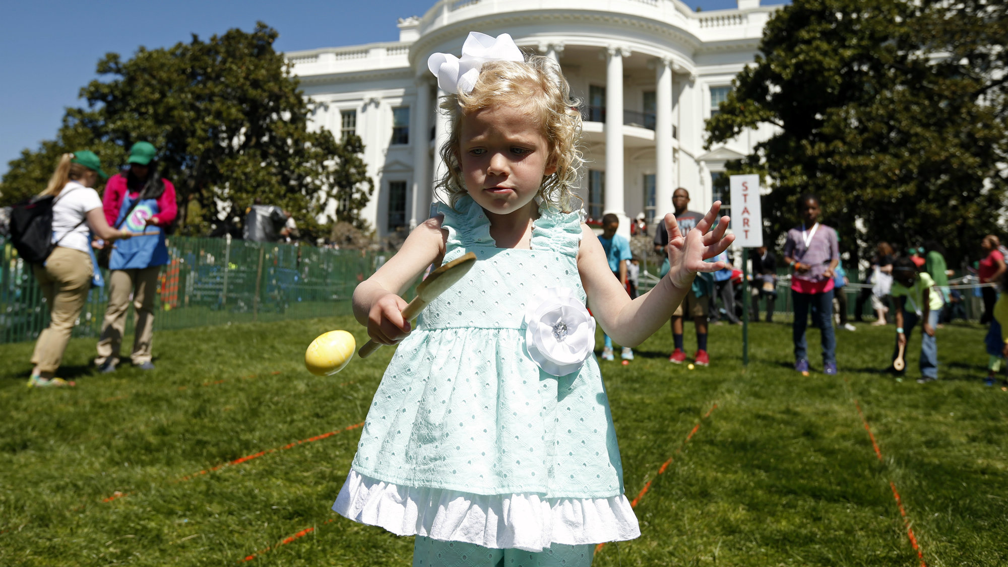 Ella Jane Michael, 4, from Fishersville, VA, takes part in the 136th annual Easter Egg Roll on the South...