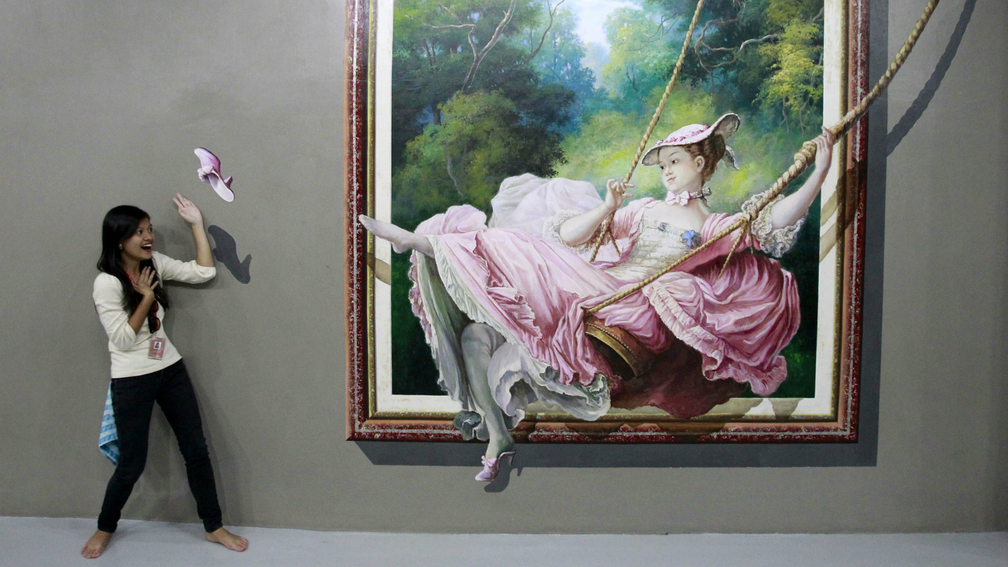 A student pose in front of a 3D painting during class field trip at the Art In Island Museum in Quezon...