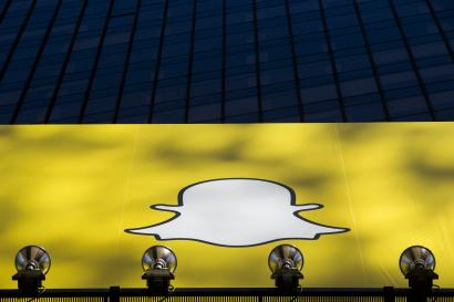 A billboard displays the logo of Snapchat above Times Square in New York March 12, 2015. REUTERS/Lucas Jackson (UNITED STATES - Tags: BUSINESS) - RTR4T57I