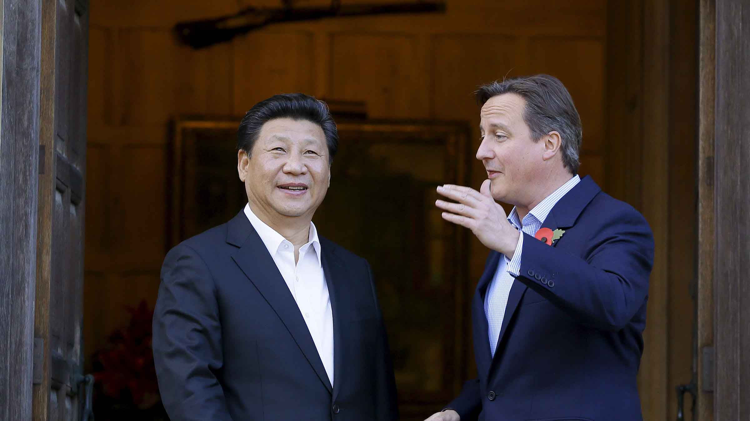 Britain's Prime Minister David Cameron welcomes Chinese President Xi Jinping to his official residence at Chequers