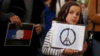 Zoe Dubes, 7, attends a vigil outside the French Consulate in response to the attacks in Paris, in Los...