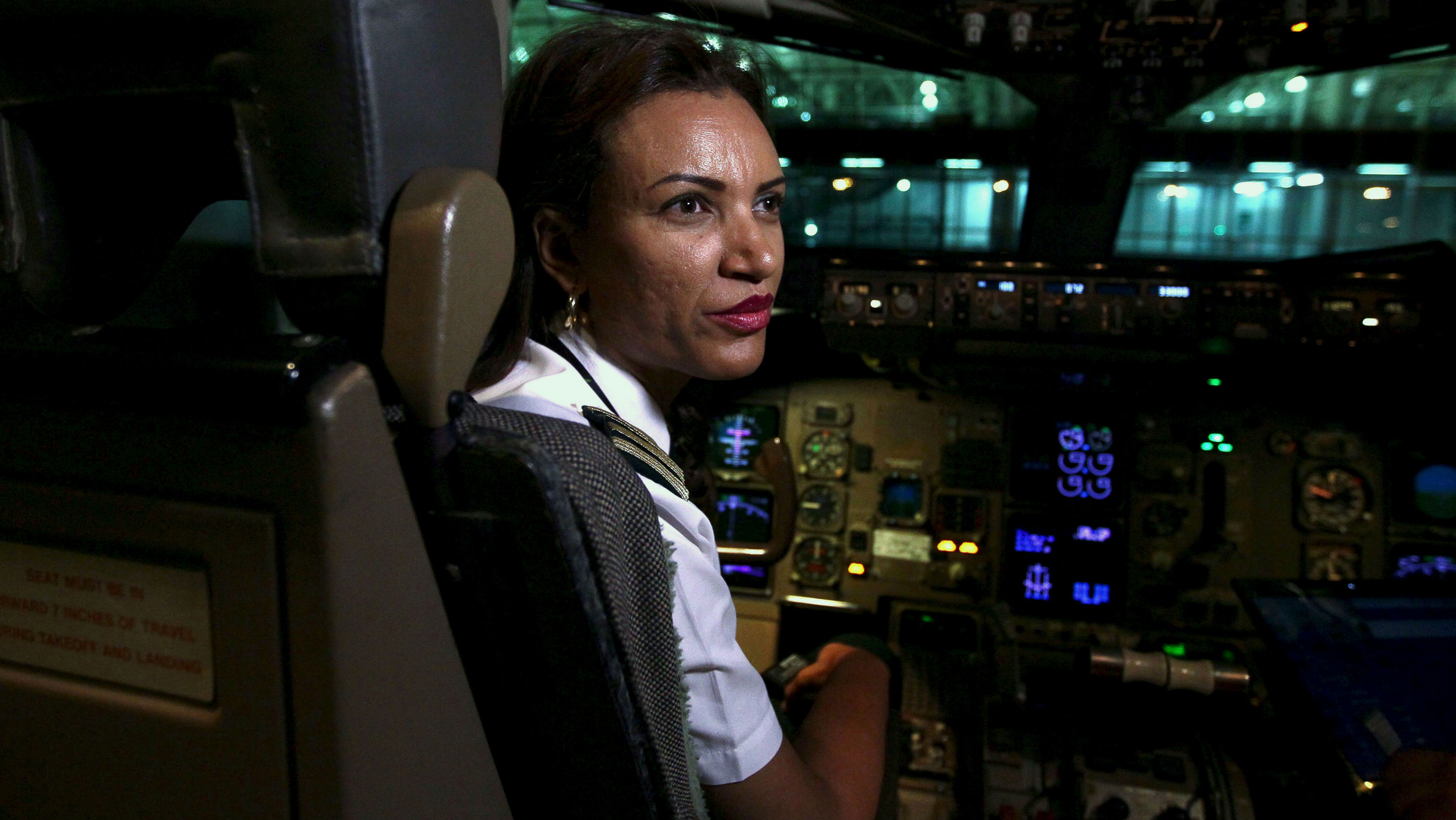 Ethiopian Airlines' first female captain Amsale Gualu prepares for takeoff at Bole international airport in the capital Addis Ababa, November 19, 2015. Ethiopia Airlines on Thursday, dispatched its first ever all-female operated flight. Every aspect of the journey was handled by women, from the ground crew, aircraft maintenance to traffic controllers. Gualu and her co-pilot were charged with flying the crew and passengers to Bangkok, Thailand. REUTERS/Tiksa Negeri TPX IMAGES OF THE DAY    - RTS80D2