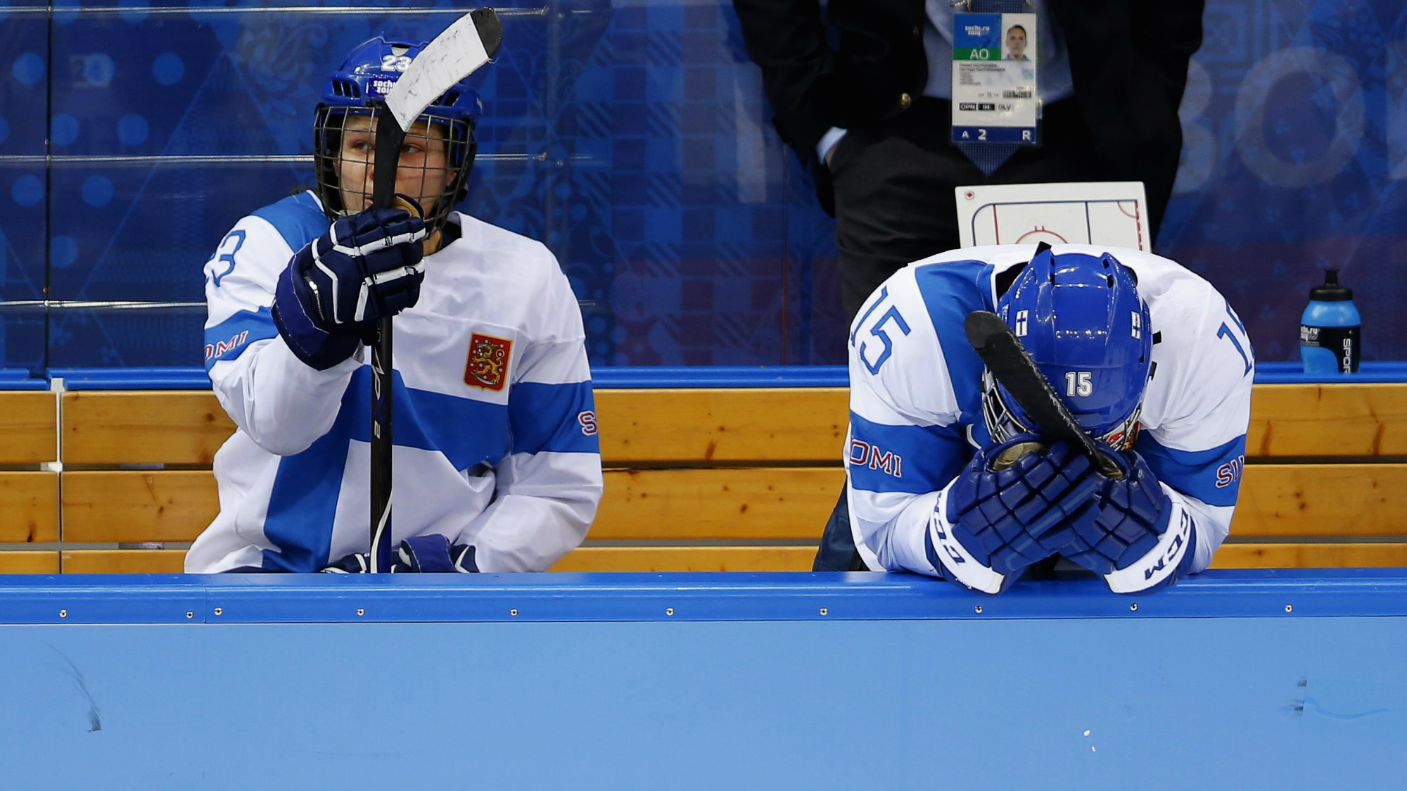 inland's Nina Tikkinen and Minttu Tuominen react after losing to Sweden in their women's ice hockey playoffs quarter-final game at the Sochi 2014 Winter Olympic Games.