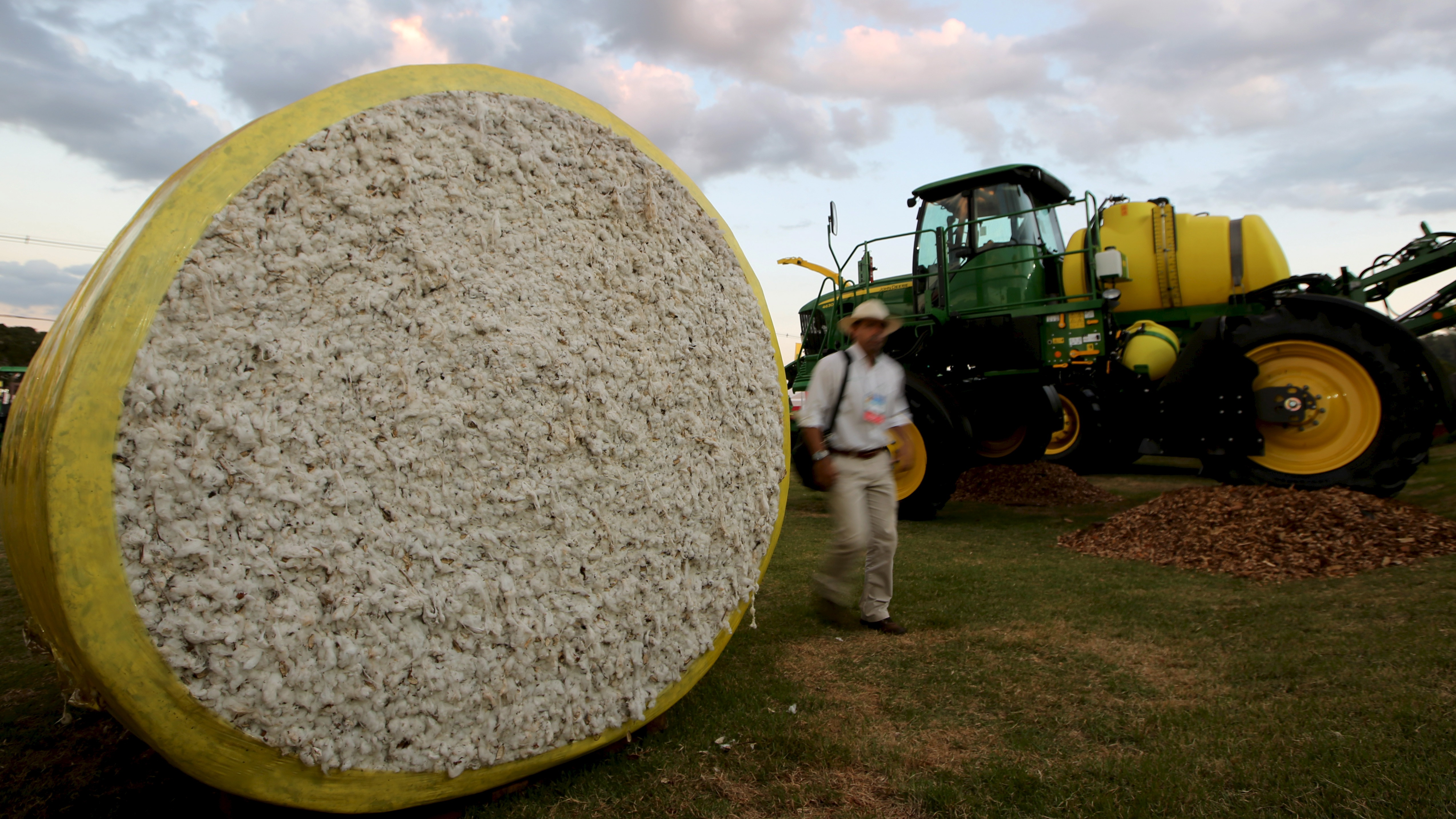 A man walks past packed cotton during Agrishow, the largest fair of agricultural machinery business in Latin America, in Ribeirao Preto, Brazil April 27, 2015.