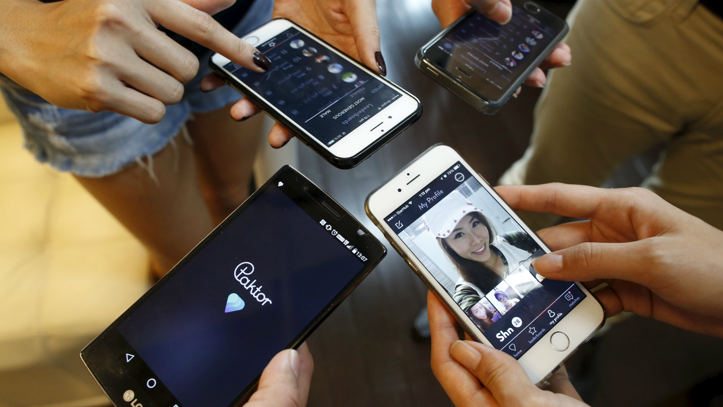 evelopers of smartphone dating app Paktor log in to their accounts to show  their Paktor profiles