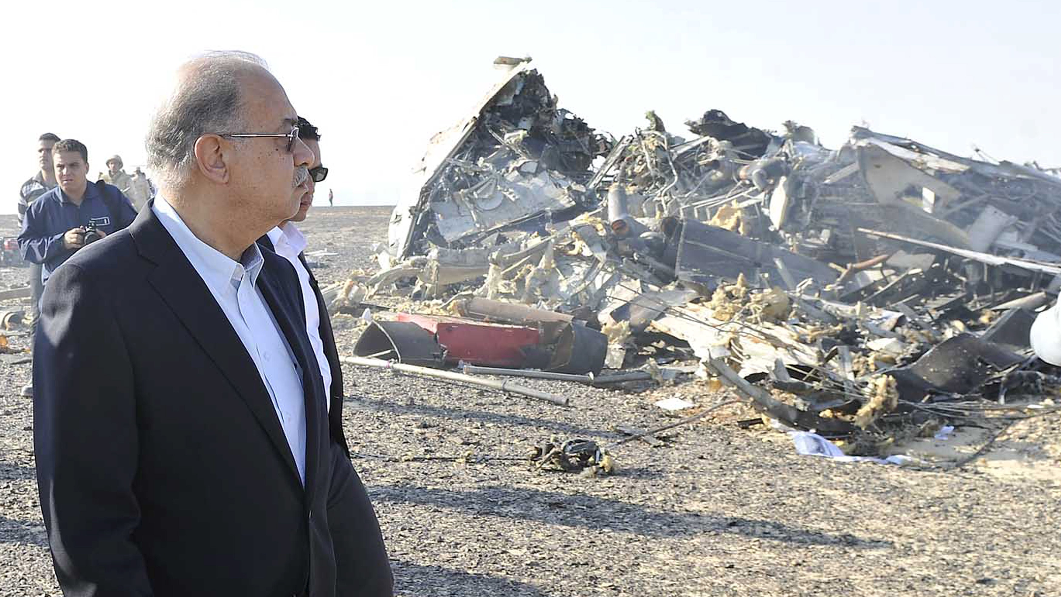 Egypt's Prime Minister Sherif Ismail looks at the remains of a Russian airliner after it crashed in central Sinai near El Arish city, north Egypt, October 31, 2015. The Airbus A321, operated by Russian airline Kogalymavia under the brand name Metrojet, carrying 224 passengers crashed into a mountainous area of Egypt's Sinai peninsula on Saturday shortly after losing radar contact near cruising altitude, killing all aboard.