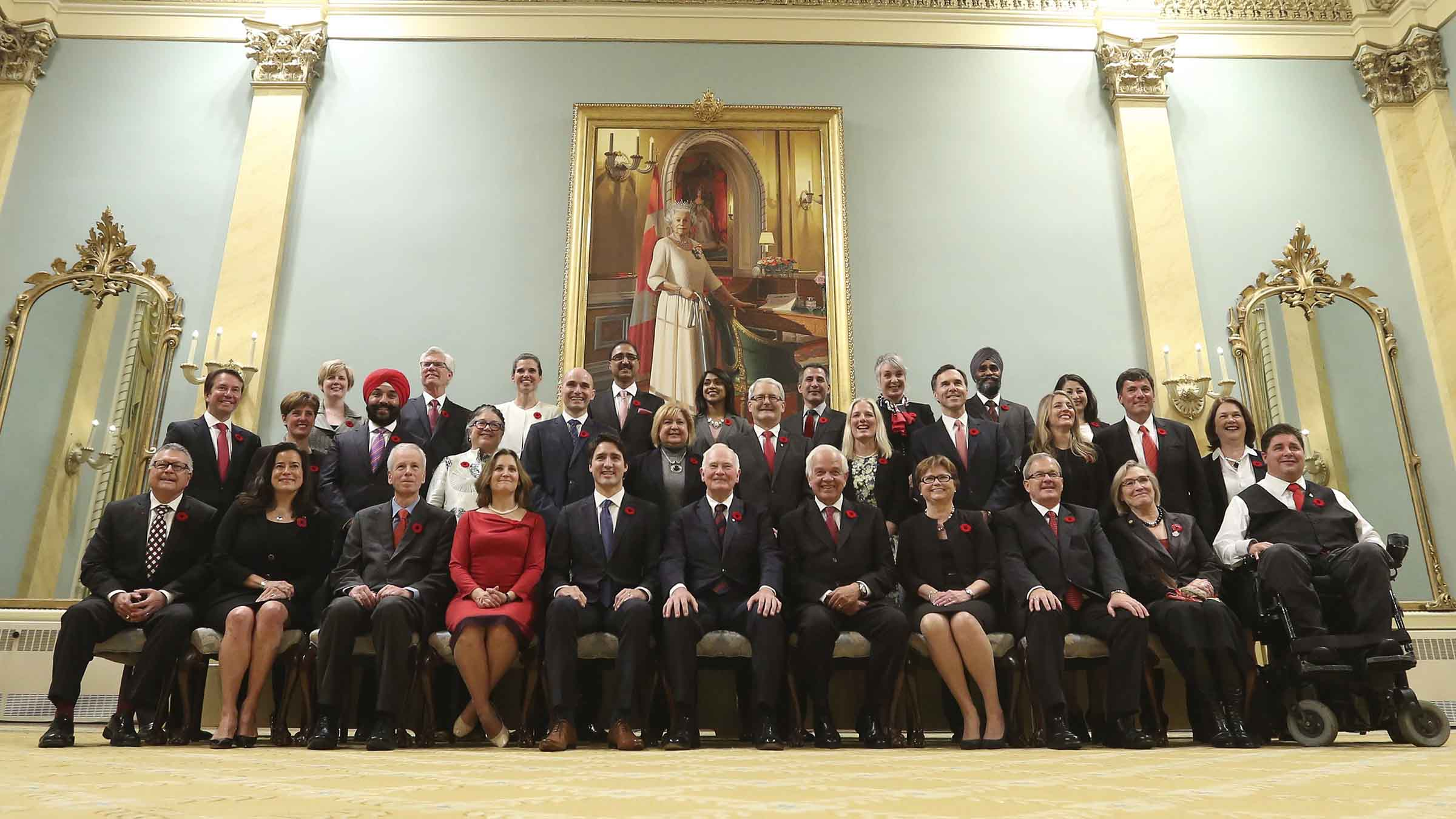 Canada's new PM Trudeau poses with his cabinet after their swearing-in ceremony at Rideau Hall in Ottawa