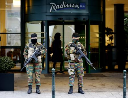 "Belgian soldiers stand guard outside the Radisson Blu hotel in central Brussels, November 21, 2015, after security was tightened in Belgium following the fatal attacks in Paris. Belgium raised the alert status for its capital Brussels to the highest level on Saturday, shutting the metro and warning the public to avoid crowds because of a ""serious and imminent"" threat of an attack."