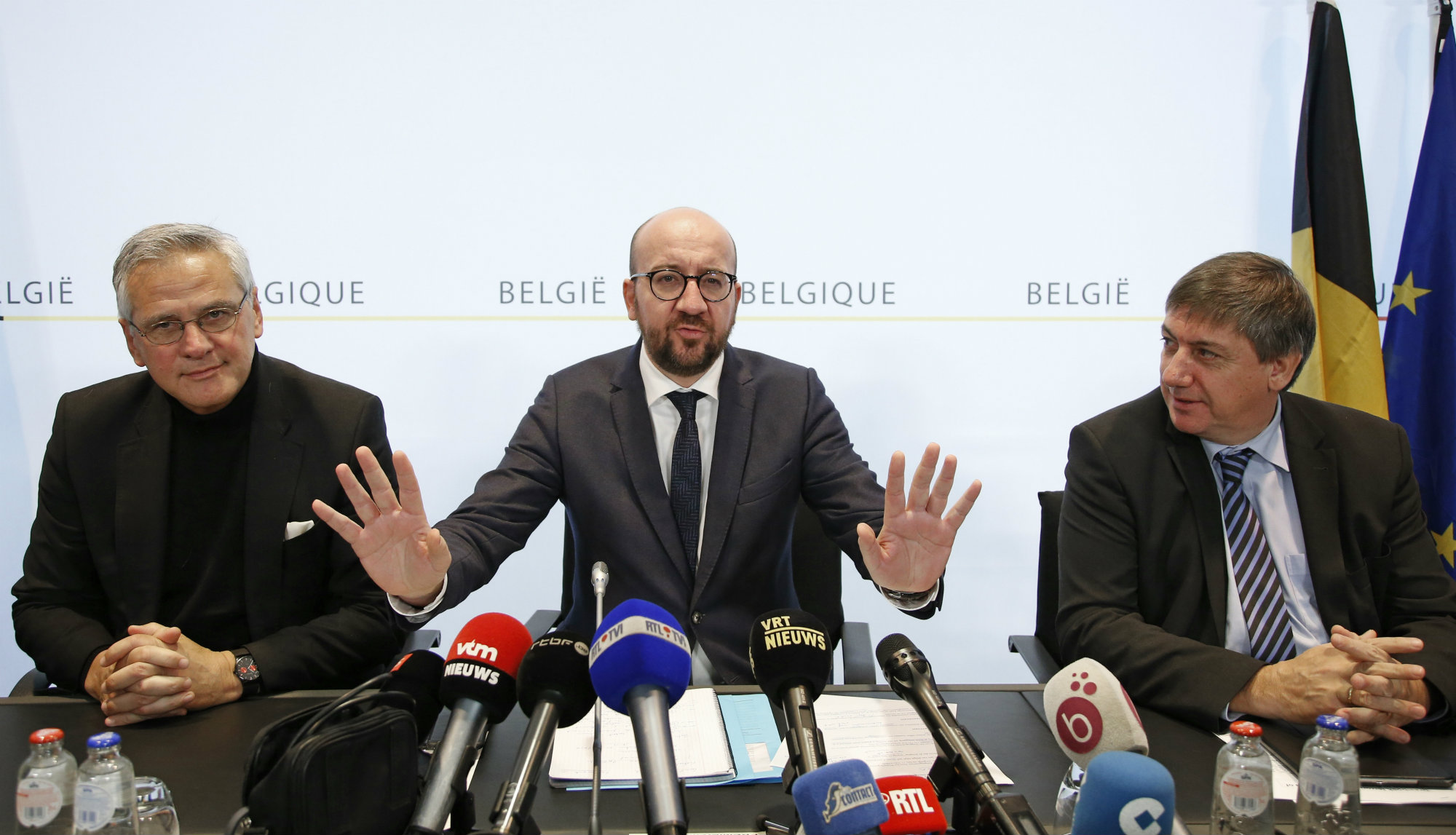 Belgium's Employment and Economy Minister Kris Peeters (L) Prime Minister Charles Michel (C) and Interior Minister Jan Jambon hold a news conference in Brussels, November 21, 2015, after security was tightened in Belgium following the fatal attacks in Paris.