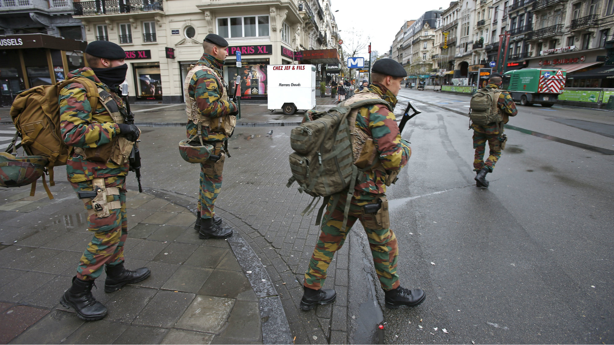 "Belgian soldiers patrol in central Brussels, November 21, 2015, after security was tightened in Belgium following the fatal attacks in Paris. Belgium raised the alert status for its capital Brussels to the highest level on Saturday, shutting the metro and warning the public to avoid crowds because of a ""serious and imminent"" threat of an attack."
