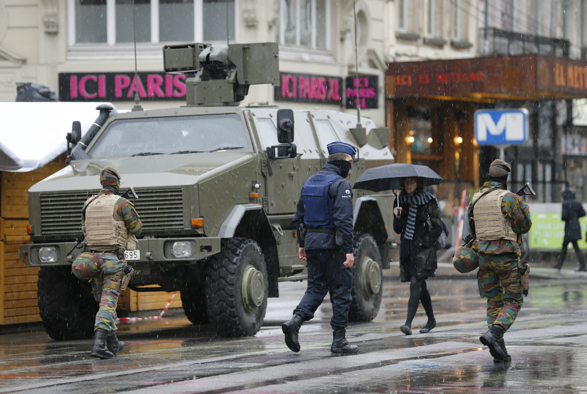 "Belgian soldiers and a police officer patrol in central Brussels, November 21, 2015, after security was tightened in Belgium following the fatal attacks in Paris. Belgium raised the alert status for its capital Brussels to the highest level on Saturday, shutting the metro and warning the public to avoid crowds because of a ""serious and imminent"" threat of an attack."