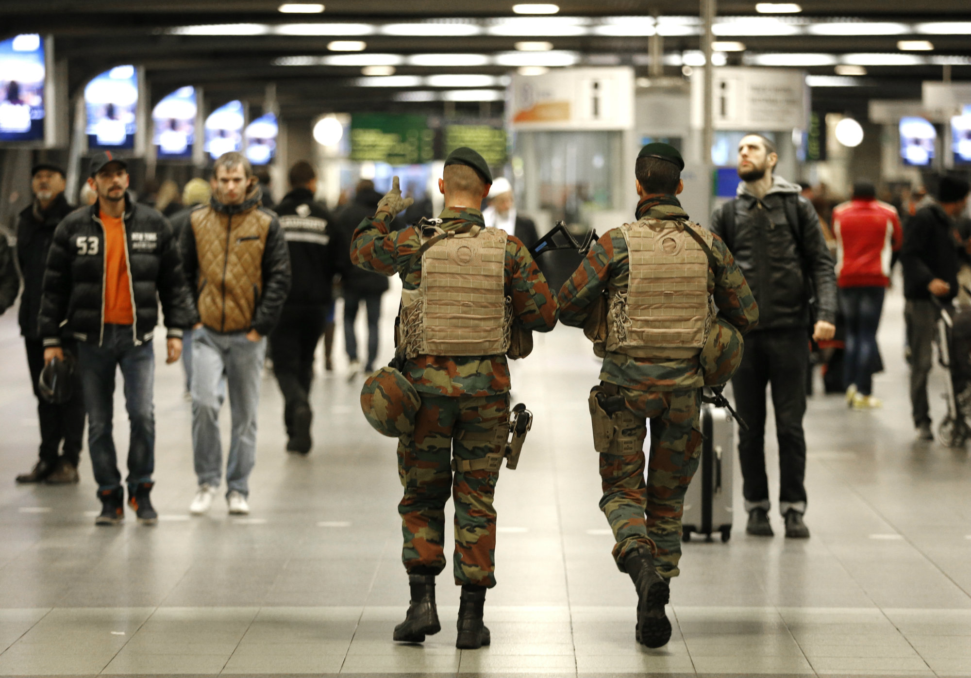 "Belgian soldiers patrol in the arrival hall at Midi railway station in Brussels, November 21, 2015, after security was tightened in Belgium following the fatal attacks in Paris. Belgium raised the alert status for its capital Brussels to the highest level on Saturday, shutting the metro and warning the public to avoid crowds because of a ""serious and imminent"" threat of an attack."