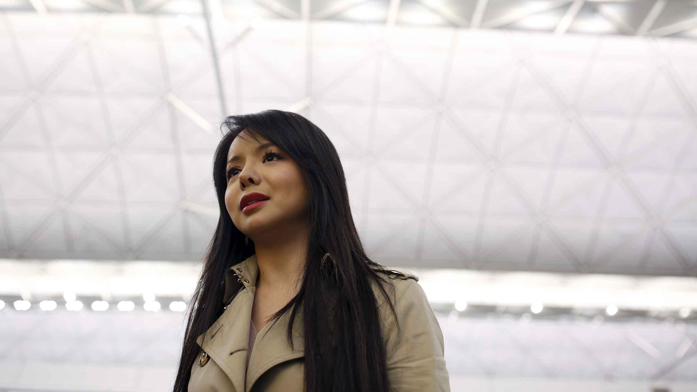 Miss World Canada Anastasia Lin poses for photo at the departure hall of Hong Kong Airport in Hong Kong, China