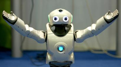 A robot gestures during a demonstration of its skill during the seventh Soccer World Championship.