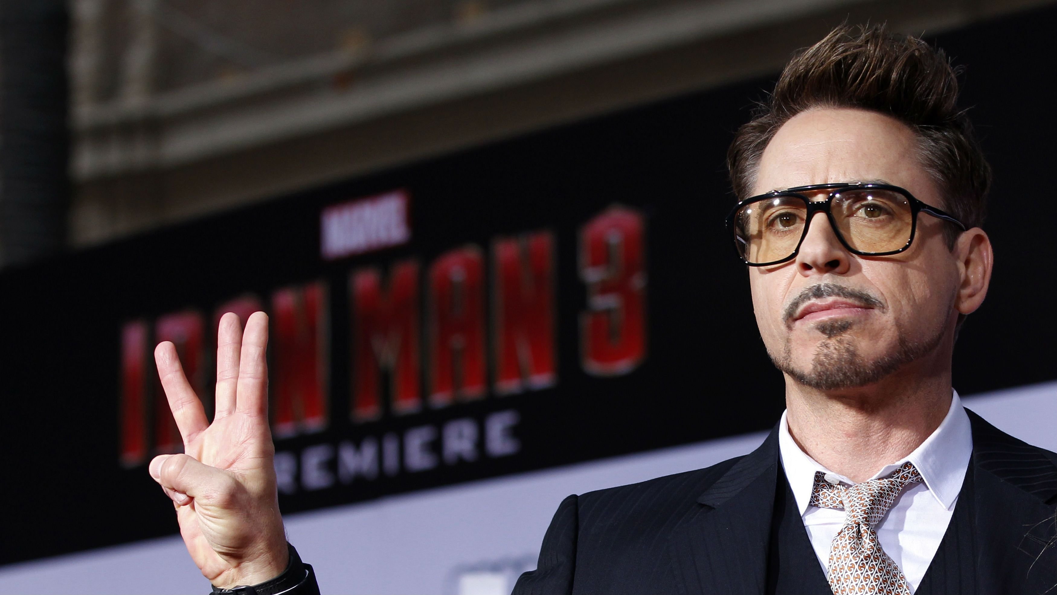 """Cast member Robert Downey Jr. poses at the premiere of """"Iron Man 3"""" at El Capitan theatre in Hollywood, California April 24, 2013. The movie opens in the U.S. on May 3. REUTERS/Mario Anzuoni"""