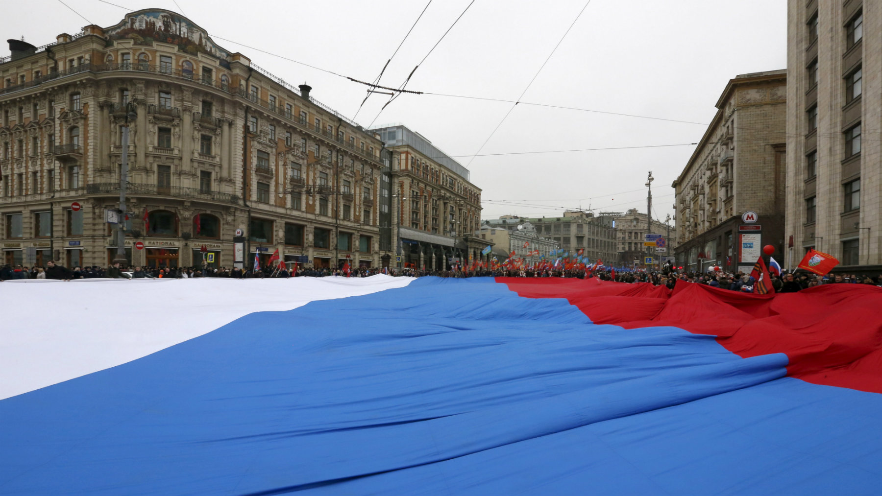 Participants march with a giant Russian national flag during a demonstration on National Unity Day in Moscow, Russia November 4, 2015. Russia marks National Unity Day on November 4 to celebrate the defeat of Polish invaders in 1612. According to the participants, they were demonstrating to demand for greater rights for all Russians. REUTERS/Sergei Karpukhin